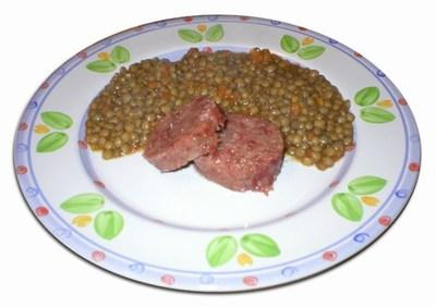 Slices if cotechino (or is it a zampone?) cooked with lentils. Not a pretty dish but there are many who just love this on New Year's Day.
