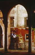 Couple coming out of restaurant near the Rialto market in Venice